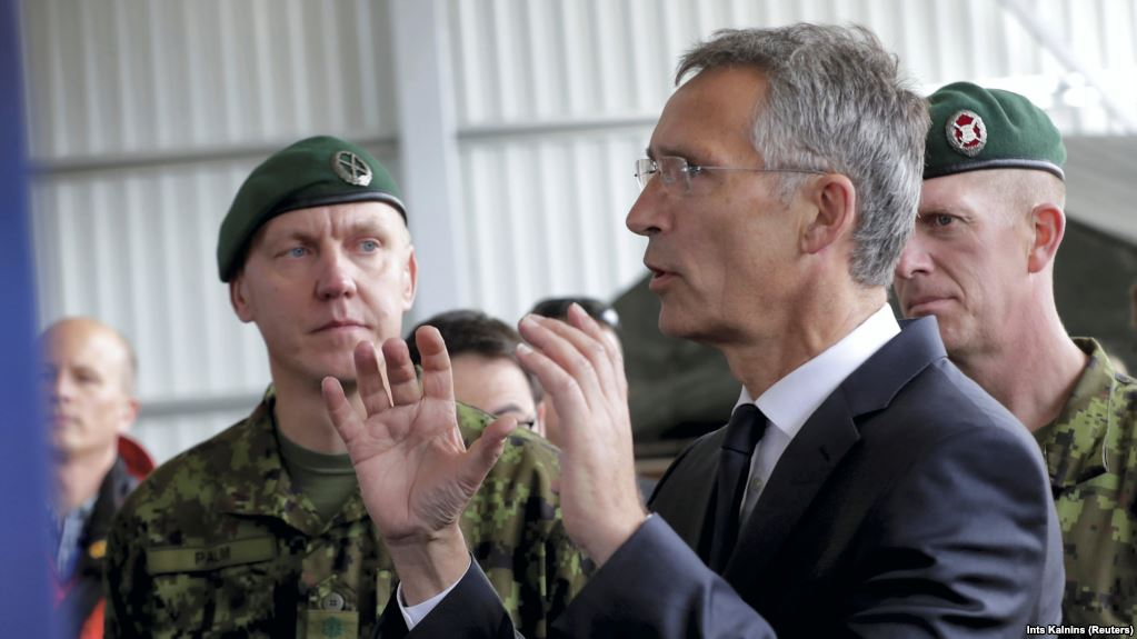 NATO chief sees no 'imminent threat' in Russia war games