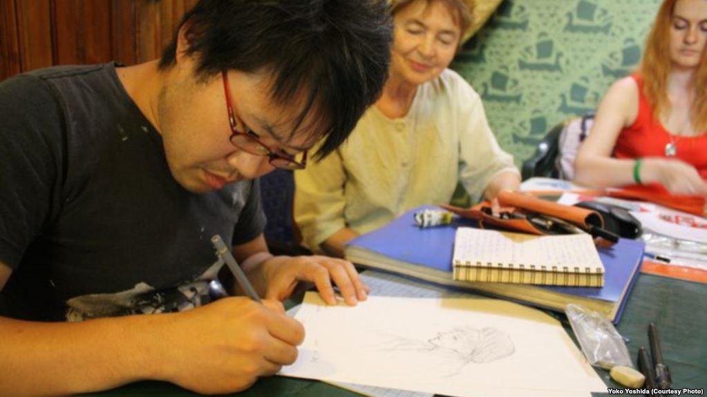 Arms Smuggler Or History Buff? Japanese Comics Artist 'Struggling' In Belarusian Prison